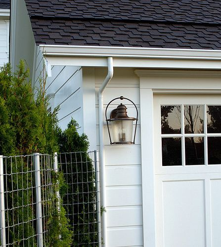 White farmhouse cottage where dreams reality meet garage exterior garage lighting mozeypictures Images