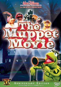 """Muppets Muppet Movie: Kermits 50th Anniversary Edition: After a fateful meeting with a big-time talent agent, Kermit heads to Hollywood dreaming of showbiz. Along the way, Fozzie Bear, Gonzo, and Miss Piggy join in hopes of becoming film stars too. But all bets are off when Kermit falls into the clutches of Doc Hopper (Charles Durning), a fast-food mogul seeking to promote his French-fried frog-leg franchise! Featuring """"The Rainbow Connection"""". Fully restored and remastered."""