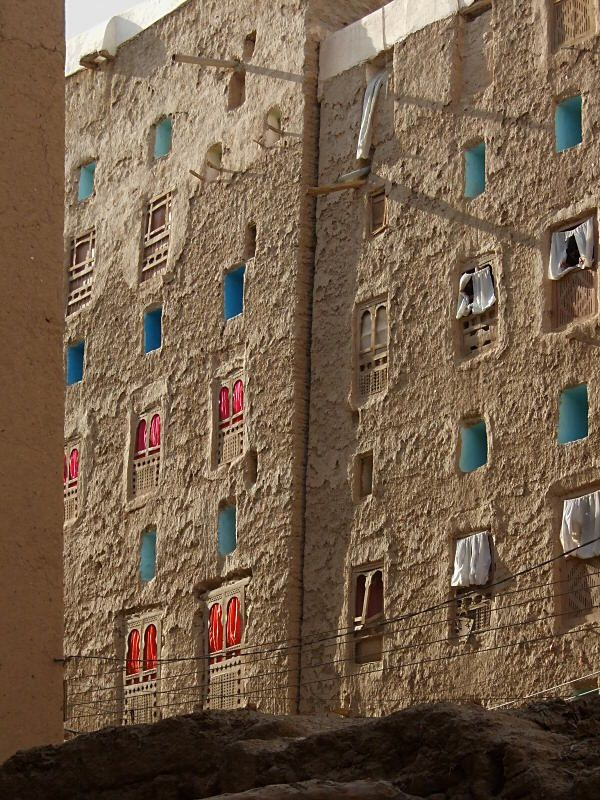 Windows and curtains - Shibam, Hadramawt  form photography   the wall is flat but you can see the texure