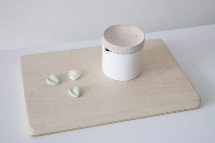 White porcelain pitcher and maple board by Mjolk: Remodelista