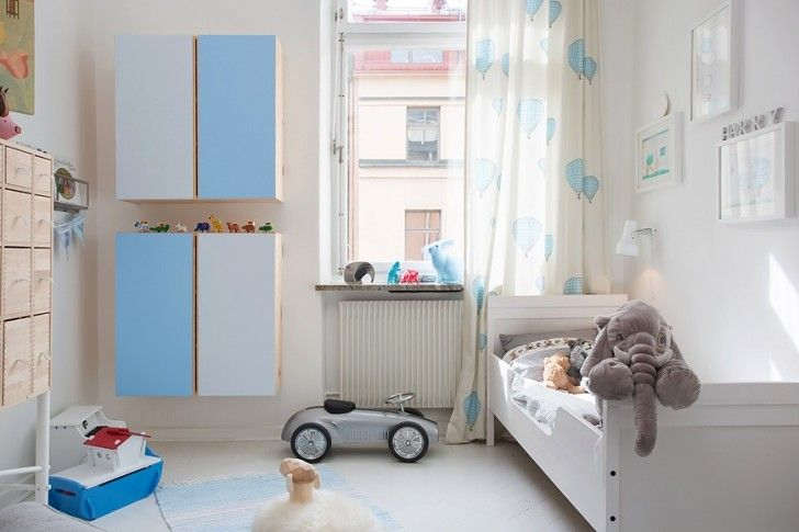 Interior Design, Kid Room White Wooden Floor Blue Sky Carpet Glass Window Curtain Mounted Wall Cabinet Wall Lamp Blanket Pillow And Wooden Headboard ~ Charming White Apartment Interior Sporting Lovely Colorful Decor