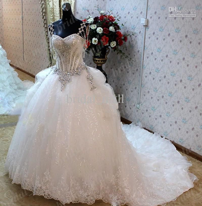 Royal wedding dresses cap sleeve crystal beaded puffy ball gown pure ...