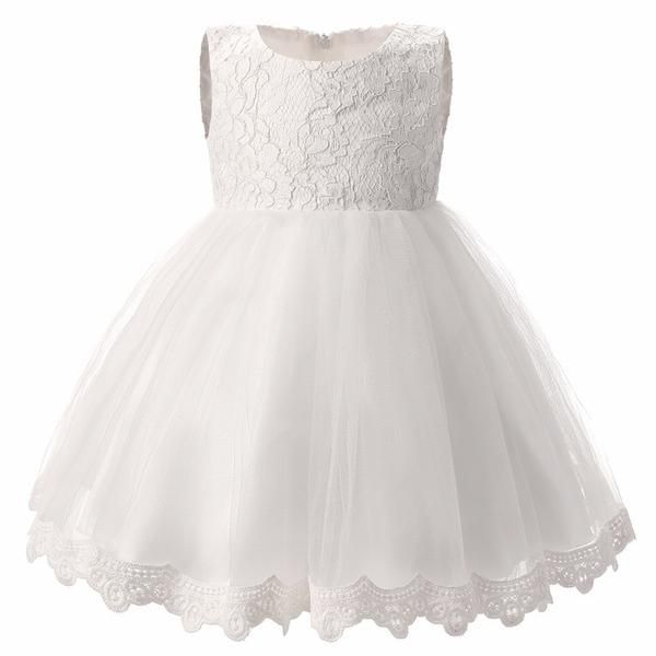 8a2b6772bb This delicate white dress is perfect for your little lady. It includes a  lace top