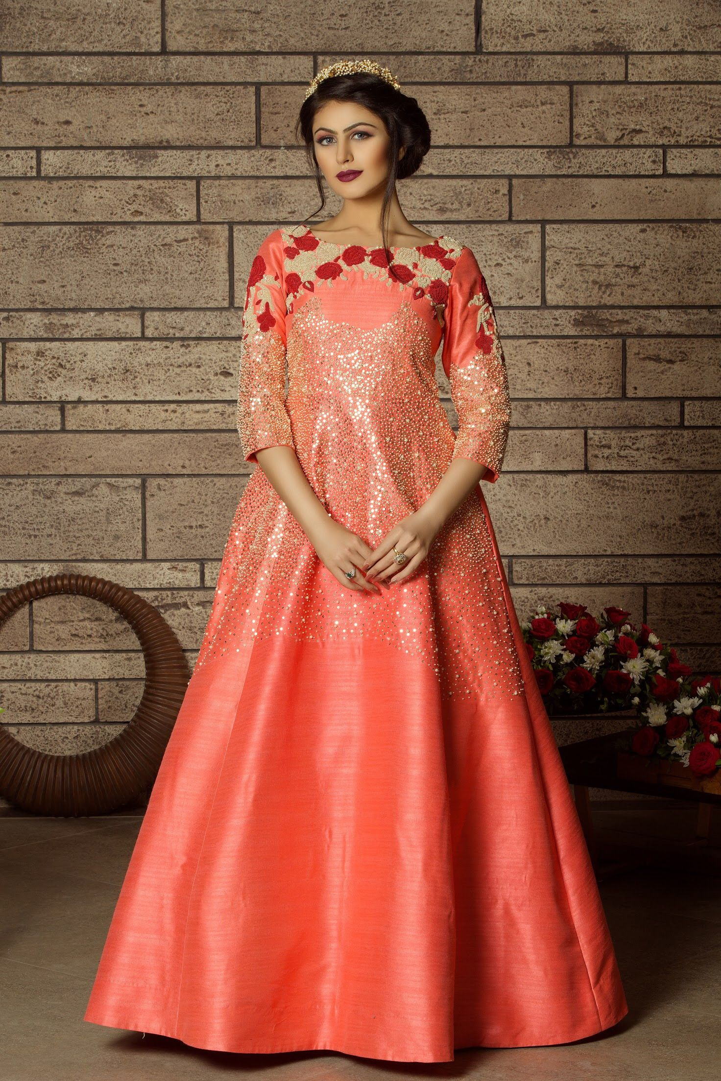 A lovely peach bridal gown with colorful handwork