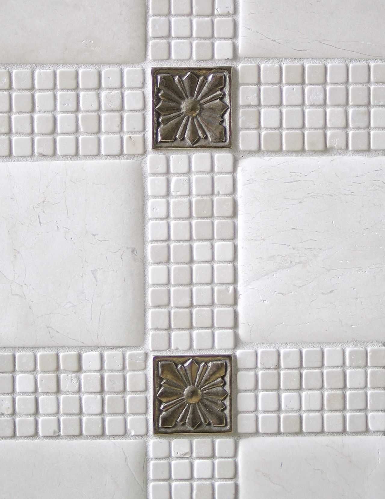 Metal accent tile: Sunrise in White Bronze with limestone mosaic ...