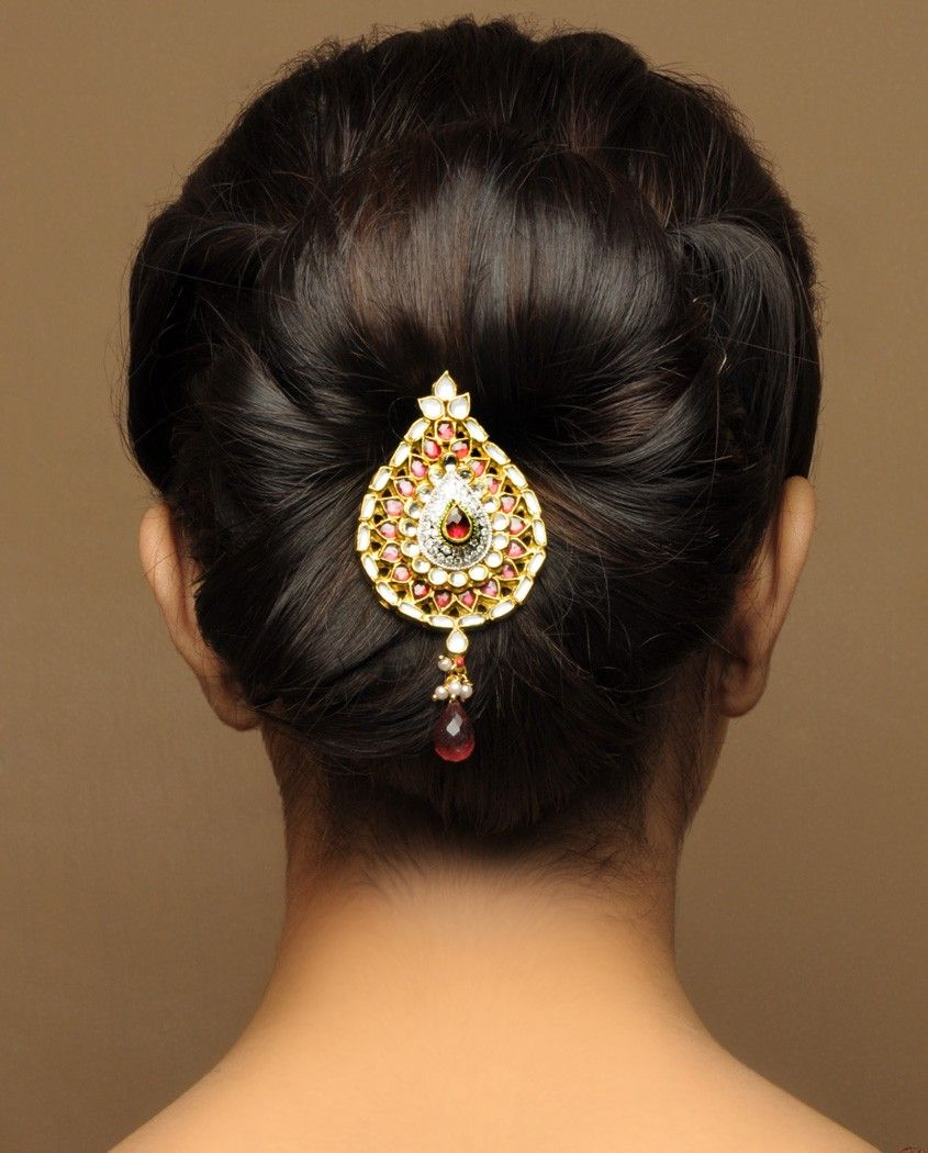 what a beautiful large low bun with beautiful ornaments