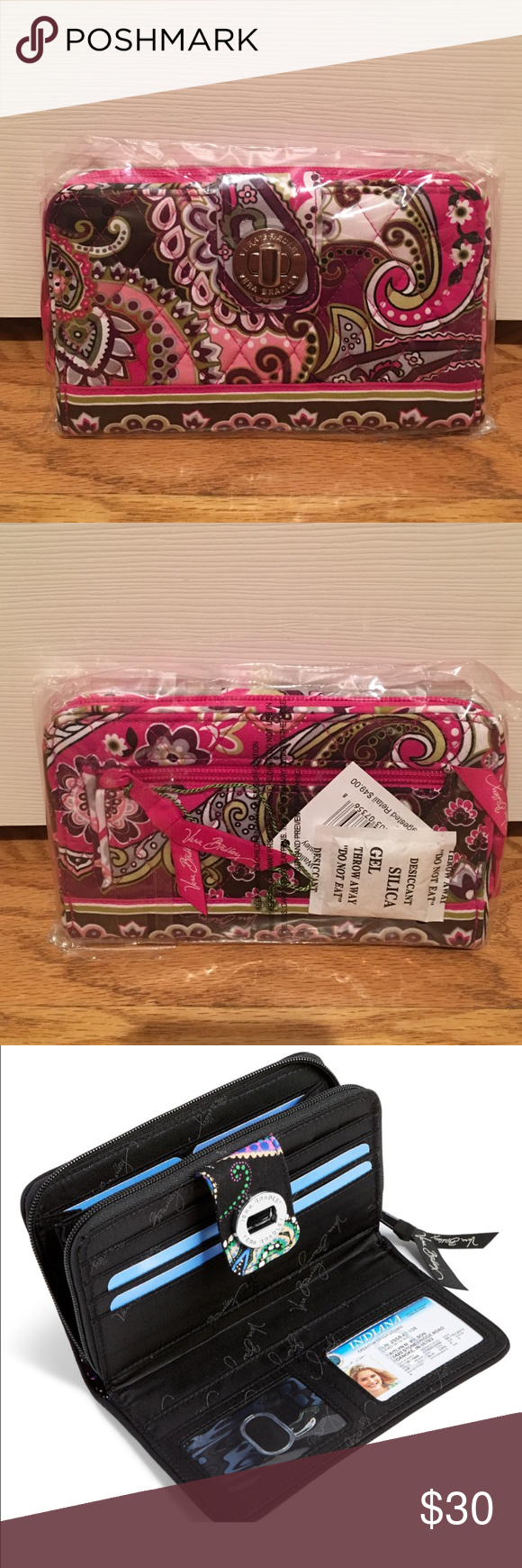 Vera Bradley Turn and Lock Wallet Turn and lock wallet in Very Berry Paisley pattern. Completely untouched in packaging still with price tag! Third picture shows the inside pockets and slots available. Vera Bradley Bags Wallets