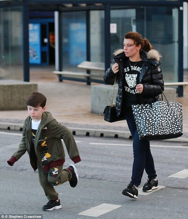Jet-setter: Coleen Rooney showed no signs of slowing down her hectic lifestyle as she race...