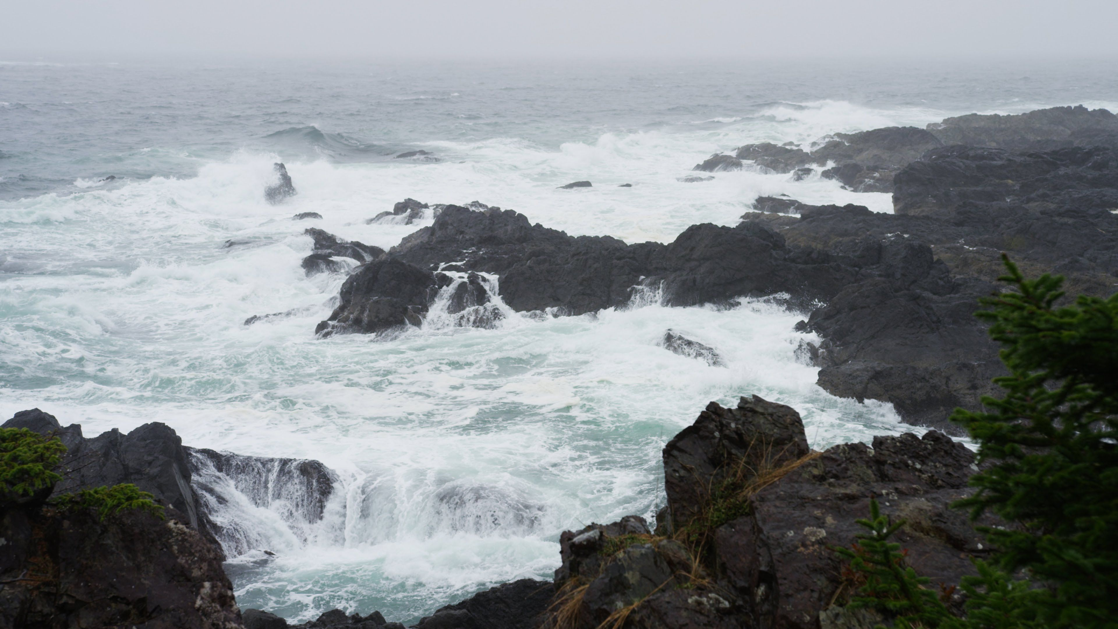 Rain sounds and ocean waves crashing on rocks with distant thunders