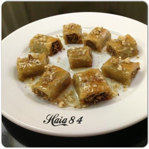 Arabian Style Baklave Rolls Stuffed With Walnuts Cinnamon Honey And Covered With Sugar Syrup Flavored Wit Delicious Desserts Homemade Recipes Dessert Recipes