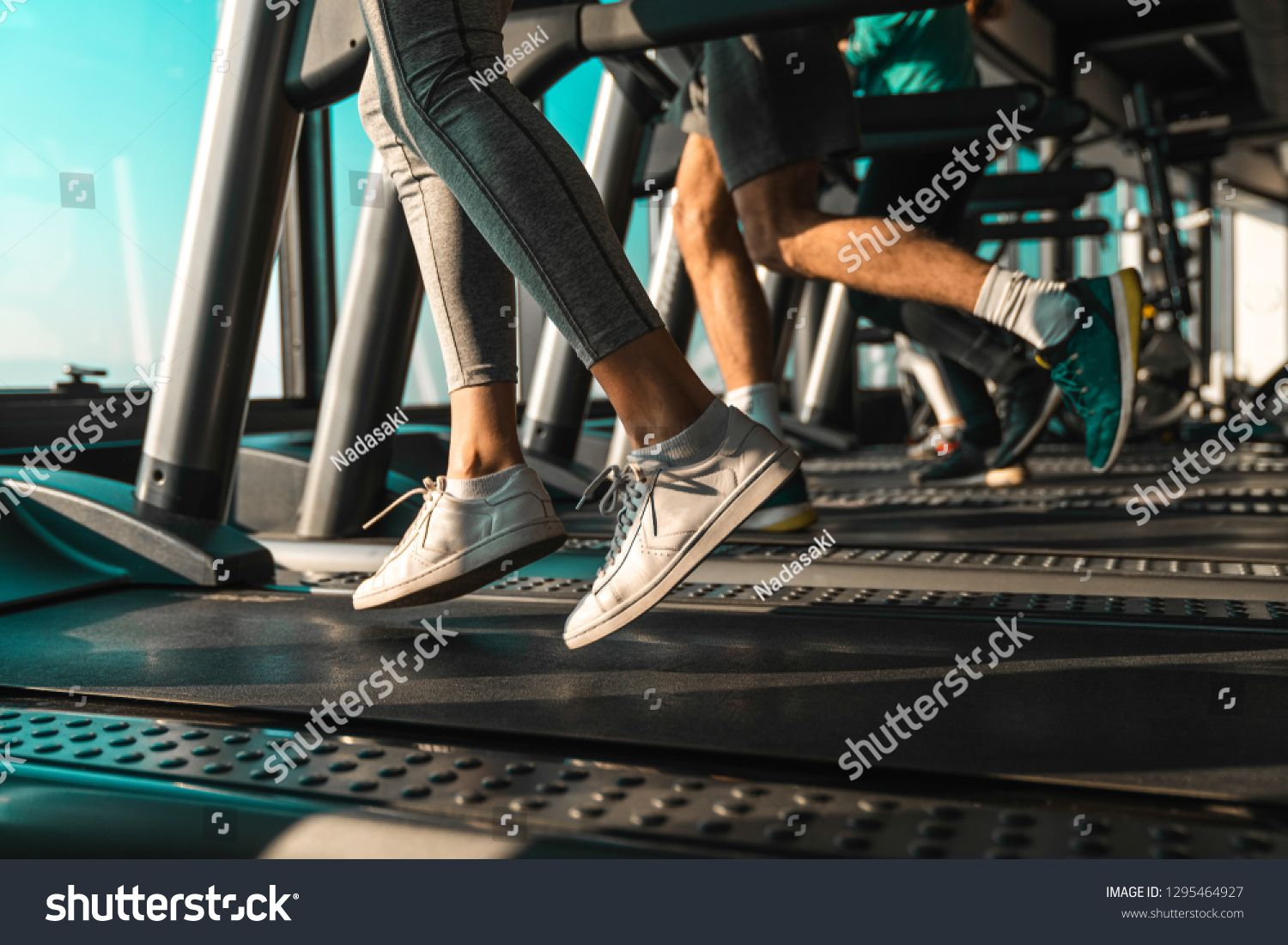 Picture of people running on treadmill in gym ,