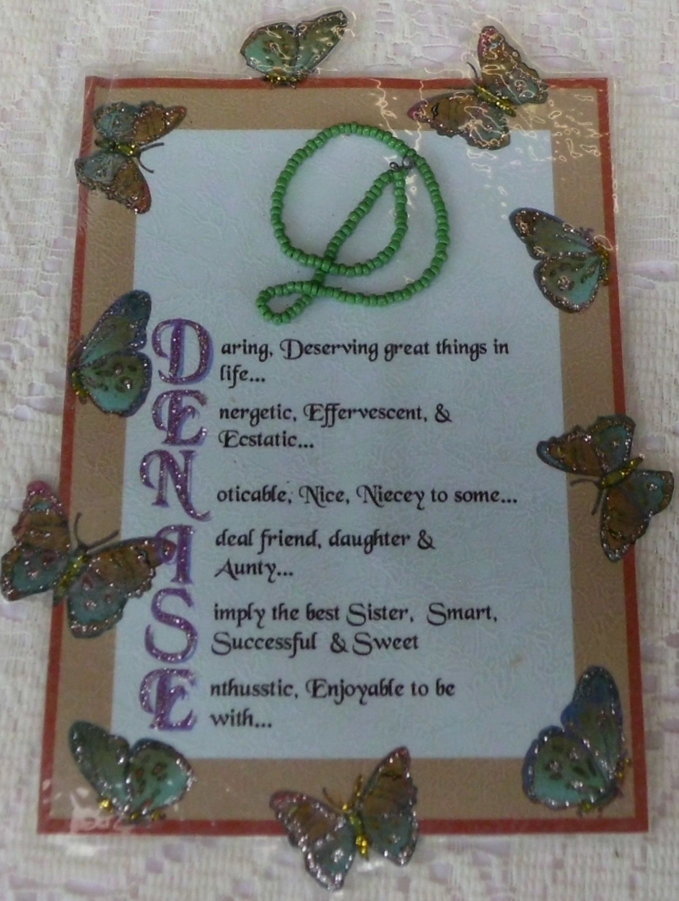Beads threaded onto wire and shaped into a letter, then sewn onto ...