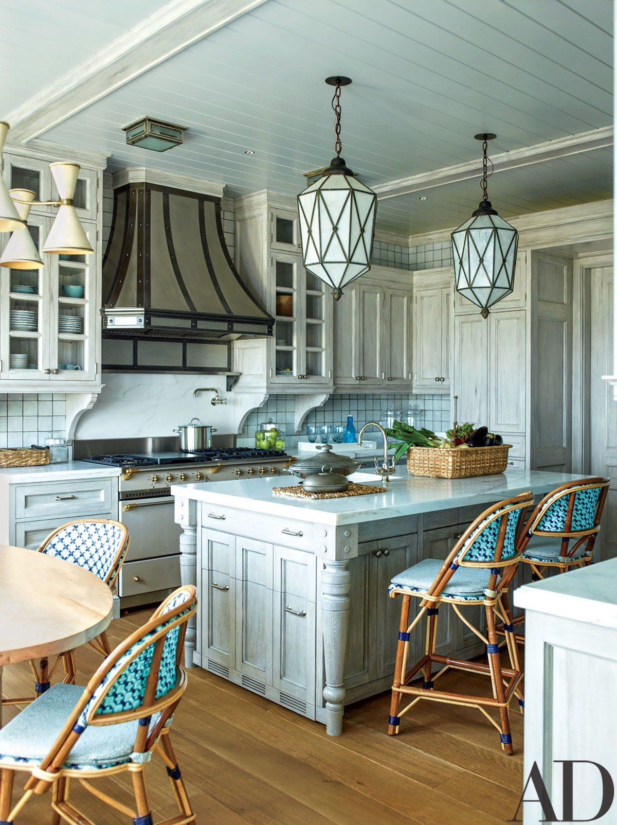 The kitchen is appointed with a RangeCraft hood, a Lacanche range ...