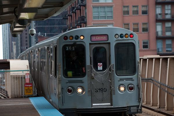 A Cta L Train Stops At Lake And Clinton Streets In Chicago Land