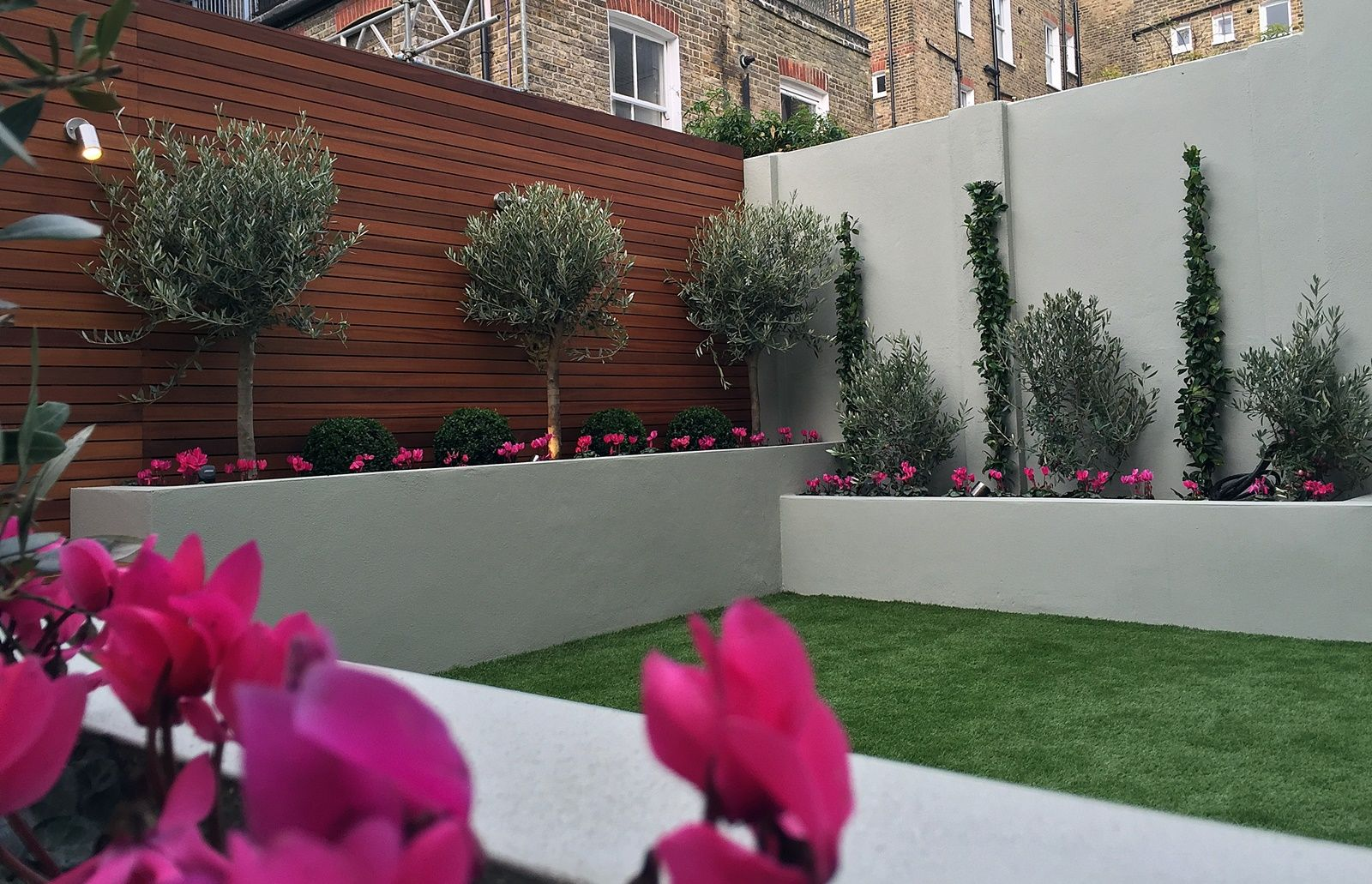 Raised render block beds artificial grass lawn olive trees buxus topiary small modern garden - Garden ideas london ...