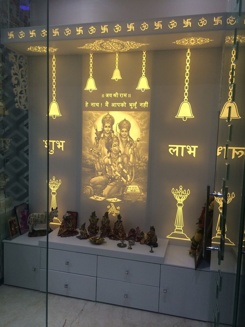 Exclusive And Simple Mandir In White Arctic White Corian With LED Backlite Shades Corian