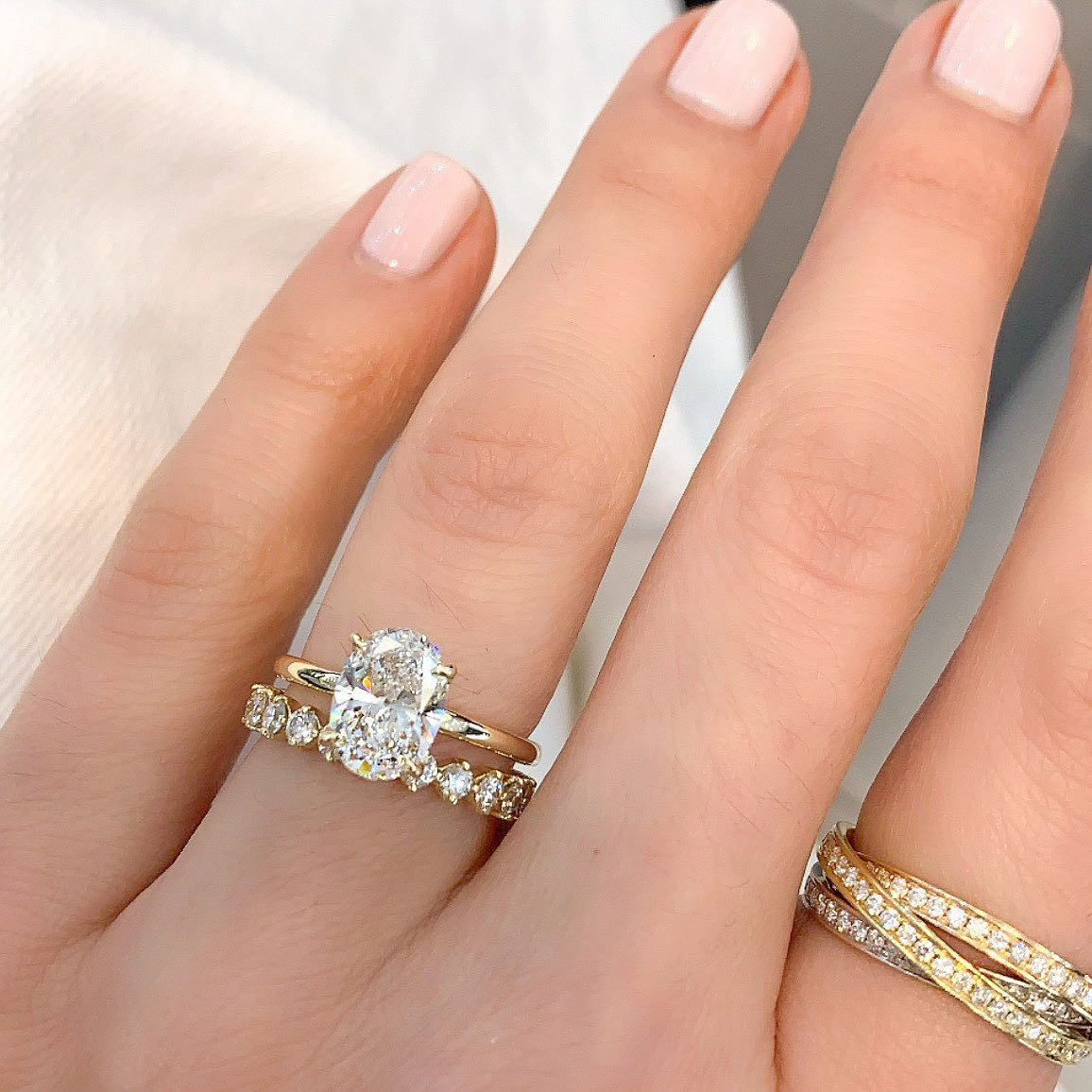 Quick Help Our Client Pick Which Wedding Band Goes Best With Her Oval Solitaire Ring Swipe Oval Wedding Band Wedding Rings Oval Jewelry Rings Engagement