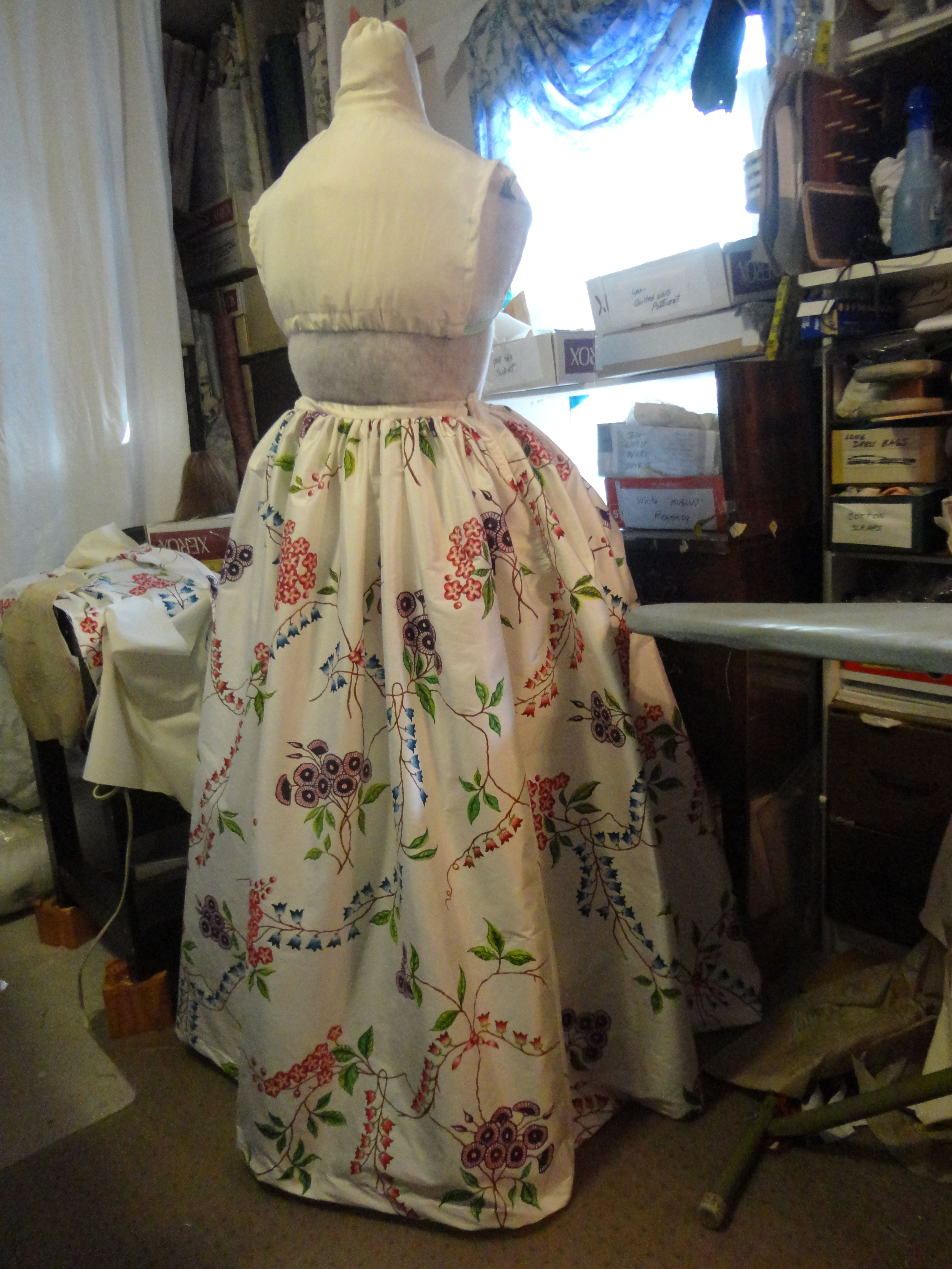 Hand-painted Dress. Like the original, a two-piece ensemble. The petticoat motifs were places and cut from fabric panels to match the placing of the 1780's designs.