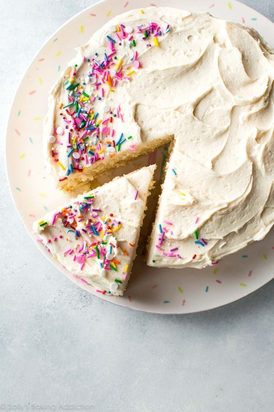 Soft, fluffy, and perfect white layer cake made from scratch!! Get the recipe on http://sallysbakingaddiction.com