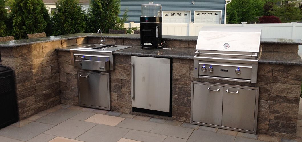 Smithtown Ny Outdoor Kitchen With Built In Grill Refrigerator Sink And Bar Seating And Yes That S A Juicer Built In Grill Outdoor Kitchen Design Kitchen