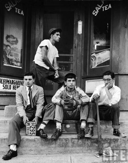 Teenage boys hang out on stoop of local storefront. Connecticut, 1949.    By Gordon Parks