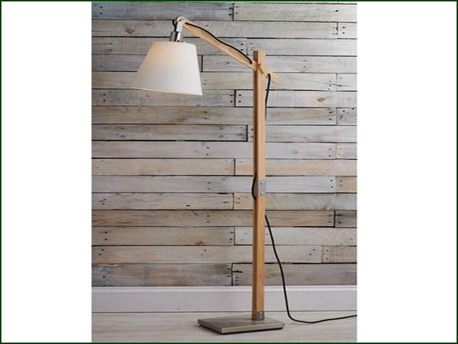 rustic wood arc floor lamp natural wood posts and satin steel accents construct this rustic adjustable arm floor lamp wood pegs adjust the height and angle