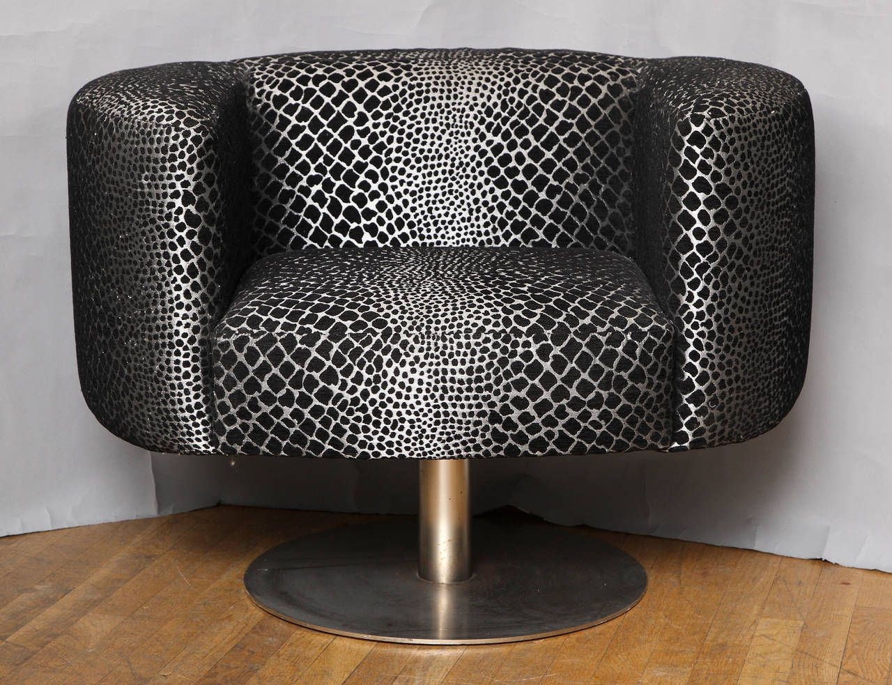 Milo Baughman Swivel Armchair | From a unique collection of antique and modern armchairs at https://www.1stdibs.com/furniture/seating/armchairs/