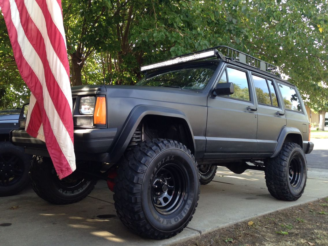 89 Jeep Xj 4 Lift New Wheels And Tires Full Width Roof Mounted Led Light Bar Custom Flat Black Paint Jeep Xj Jeep Cherokee Jeep Xj Mods