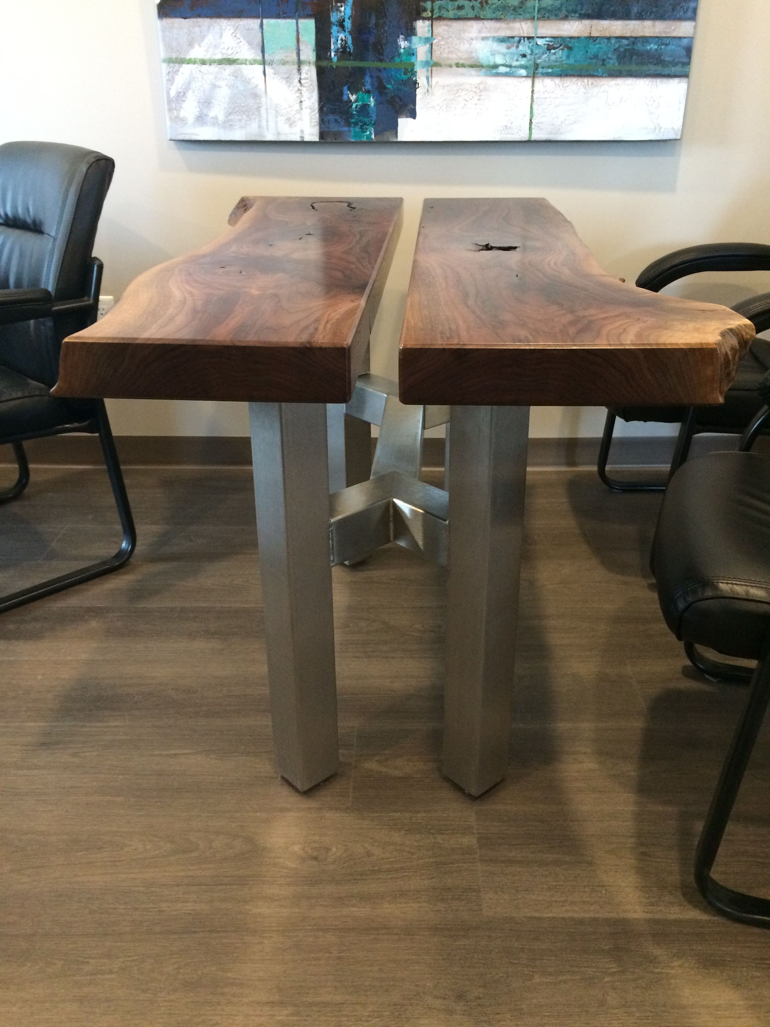 Custom stainless steel and natural wood table. Natural