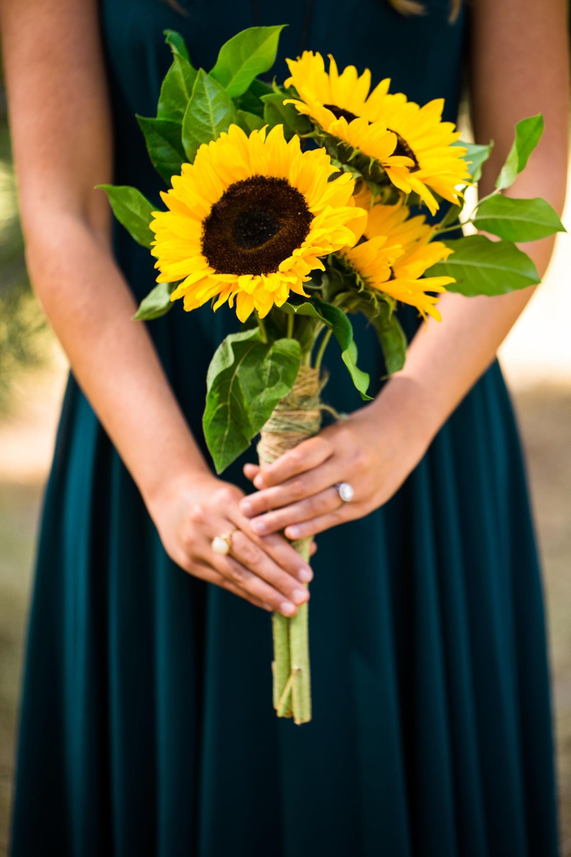 Sunflower bouquet, teal bridesmaid dress // Lauren Lindley