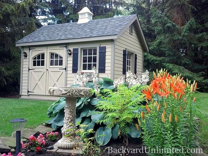 garden shed with lap siding carriage house doors wood windows gable vents and cupola