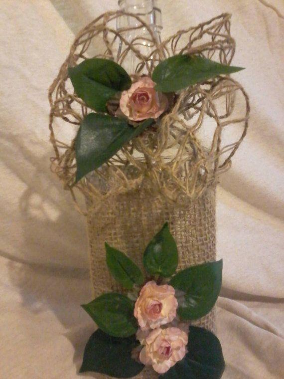 Recycled square bottle, burlap, jute ribbon, roses, leaves