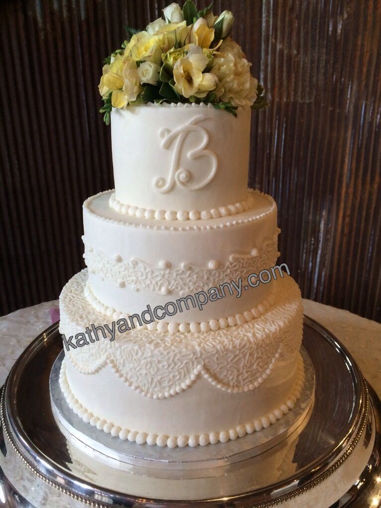 Intricate buttercream wedding cake with lace details wedding