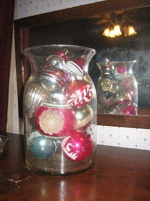 Put Old Vintage Ornaments In A Glass Vase For Safe Keeping And They