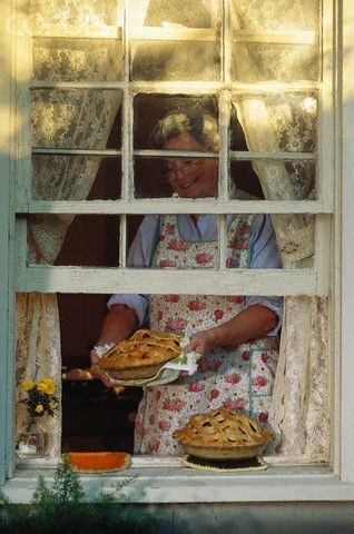 The Smell Of A Fresh Baked Pie, Out Of The Oven. A Grandmother Putting Pies  On Windowsill To Cool.