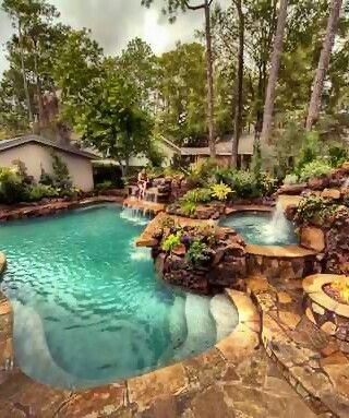 Exiting The Patio Brings You To Lagoon Style Pool With Hot Tub And Water  Fall