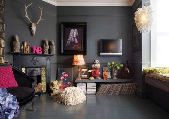 Choosing a dark, almost funereal color called Down Pipe, they transformed the lifeless walls and the floors into a dramatic, lead-gray backd...