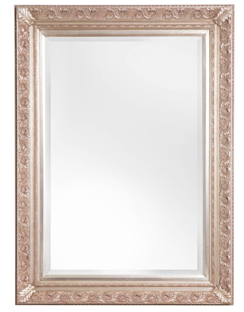 Ein Spiegel mit silbernem Barock-Rahmen, der für jeden Raum