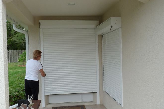 Rolling Roll Down Hurricane Shutters Rolling Roll Down And Rollup Hurricane Storm Shutters Security Shutters Hurricane Shutters Best Home Security
