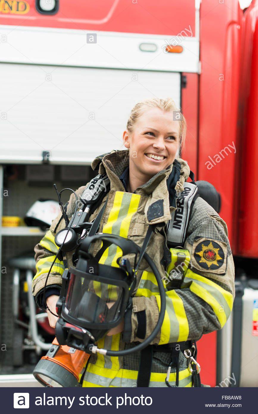 Sweden Smiley Female Firefighter Standing Next To Fire Truck Stock Photo Female Firefighter Girl Firefighter Firefighter