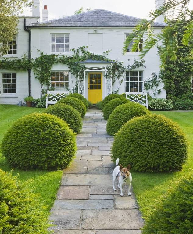 Gipsy House Buckinghamshire The Front Garden With Stone Path House With Yellow Door Clipped Yew Topiary Ba Beautiful Gardens Garden Design Landscape Design