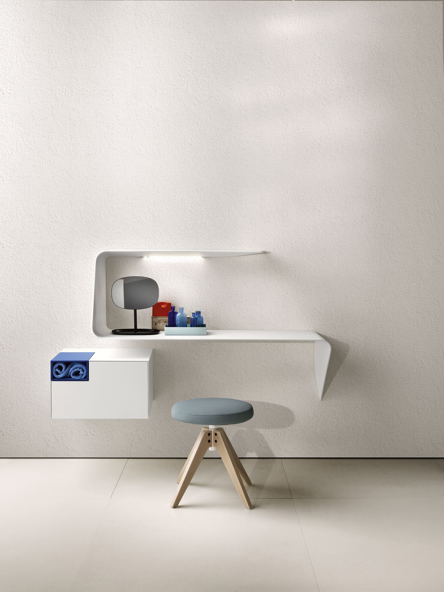 MDF Italia Mamba shelf-desk is made of Cristalplant® in matt white. The wavy shape and the tapered thickness gives the product a sober, but unique design and an image that strongly customises the environment. #designshelf #designdesk #desk