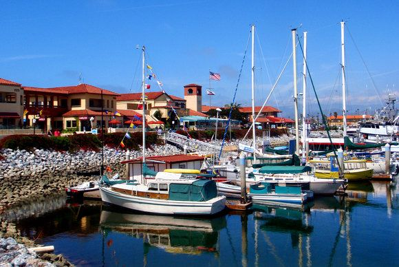 The boating and harbor life is all around the Ventura, California area.  Here Ventura Harbor reflects the boats with a floating B in the foreground.