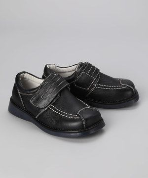 Little guys will go from playground to polished with ease in these classic leather oxfords. Soft, genuine leather feels luxurious against teeny toes, and the sturdy rubber sole and adjustable strap keep cool dudes safe on their feet while tackling those monkey bars.
