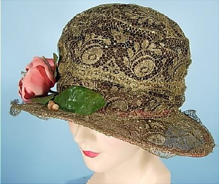 c. 1924 Glorious Gold Lame Lace Wired Cloche. Heavily wired to keep it's shape and totally covered in gold lame (the OLD great gold bullion lame!) lace and ornamented with one single large pink velvet flower to match the brim edge.