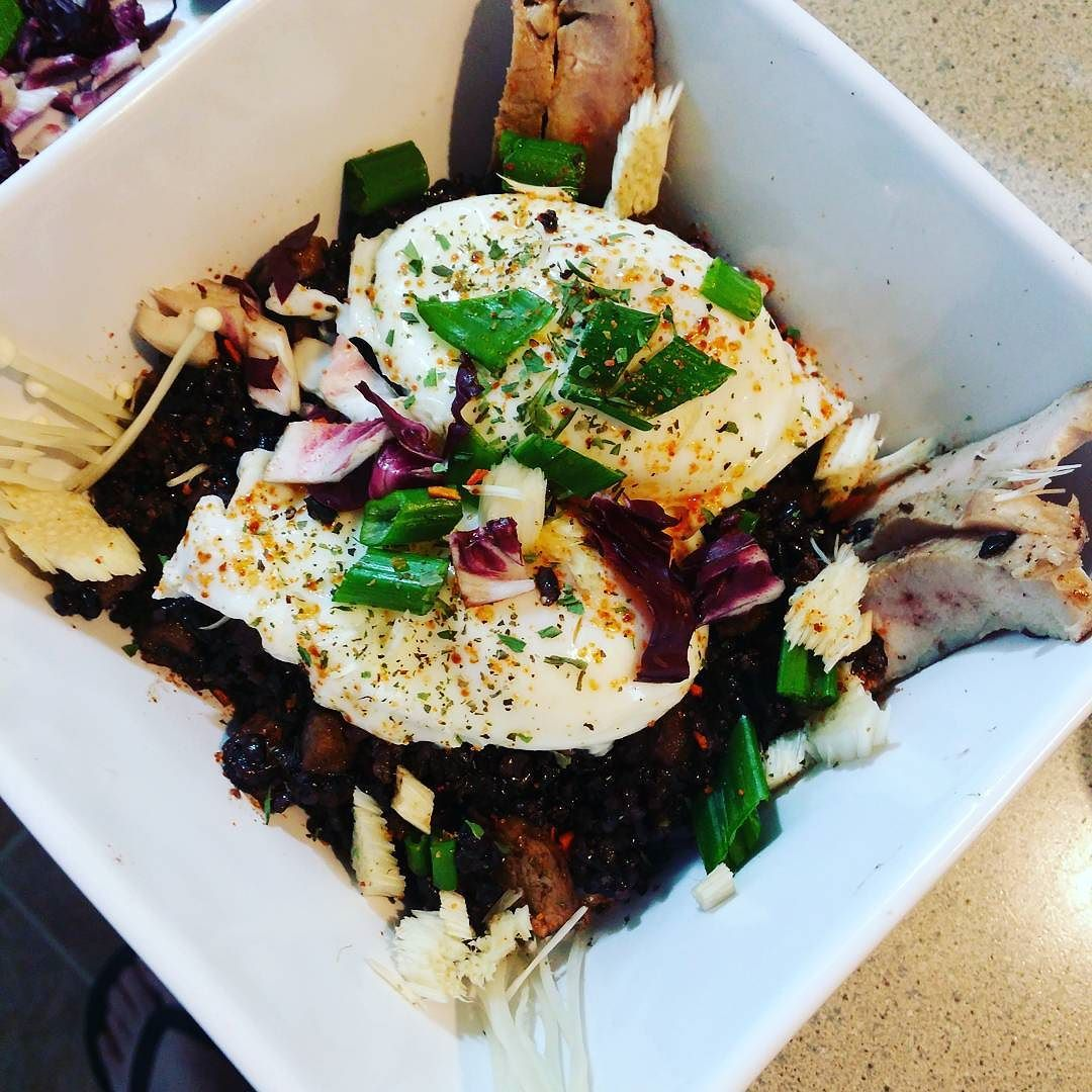 poached eggs on savory black rice pudding