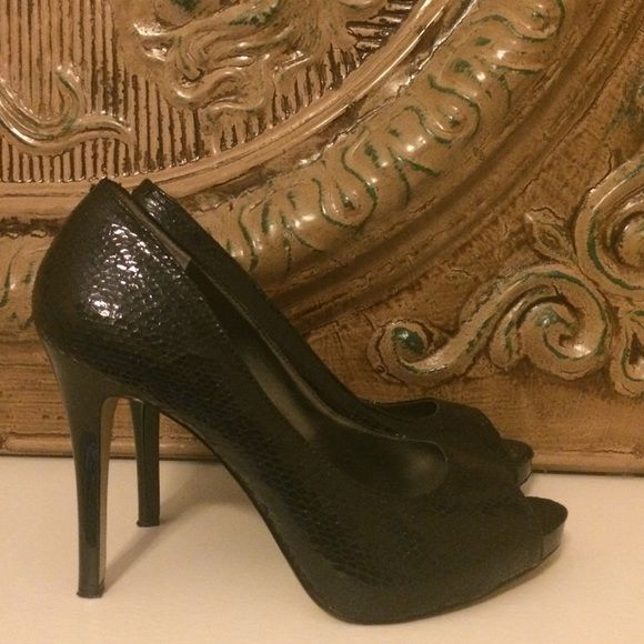 SALE!! Black snakeskin peep toe pumps Synthetic  black snakeskin peep toe pumps with 3 1:2 inch patent stiletto heel. In very good condition. Only worn a few times. Nine West Shoes Heels