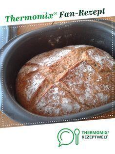 Photo of crispy Bürli bread in a roaster / Ultra