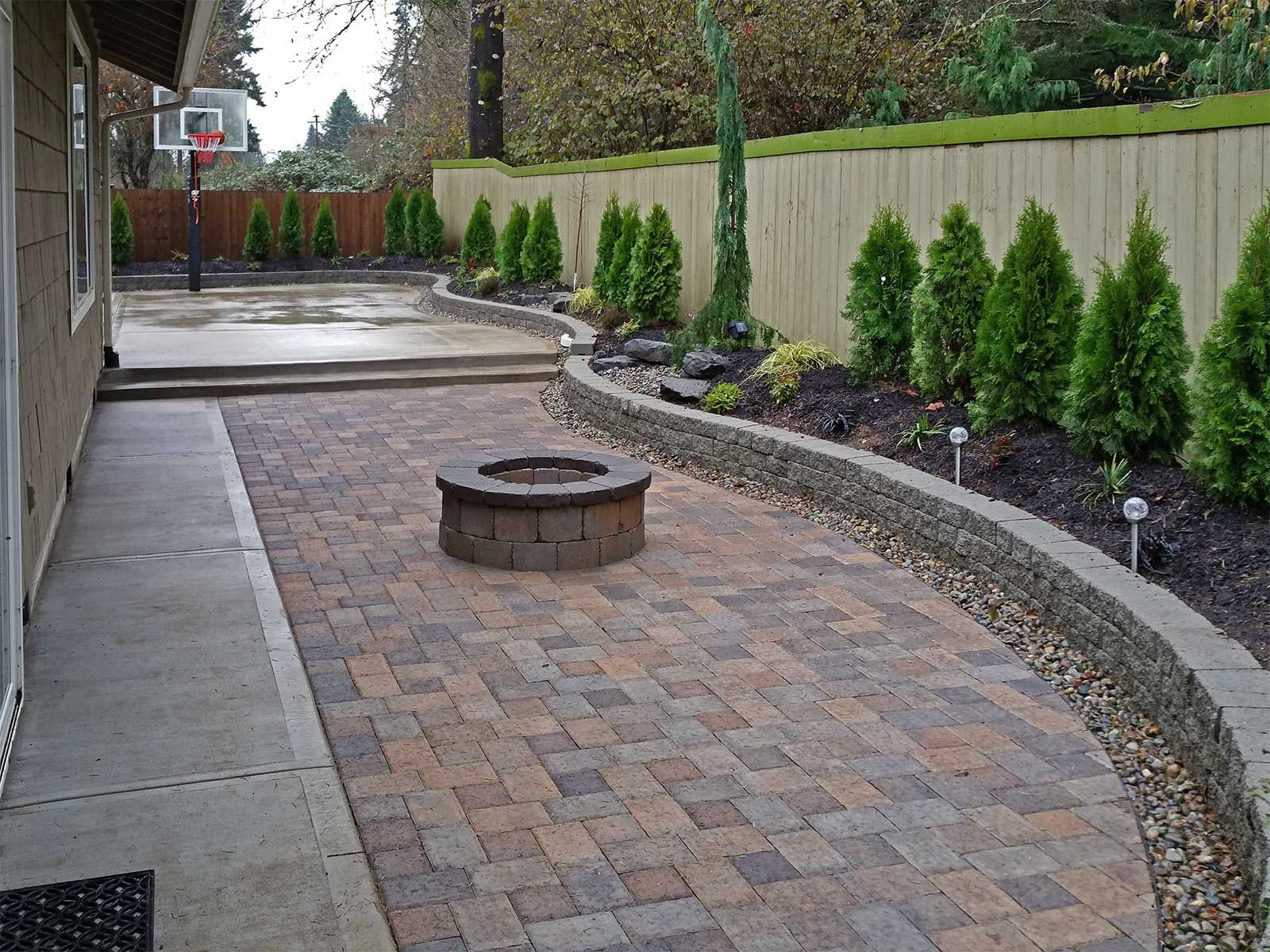 Captivating Backyard Paver Patio Connected To A Concrete Slab Basketball Court.