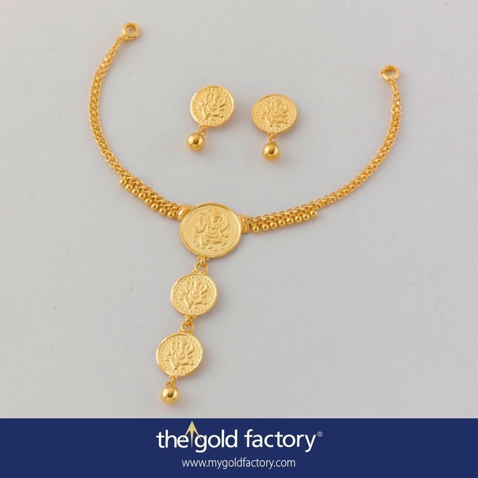 Three simplyframed ganesha coins culminating in a freehanging gold